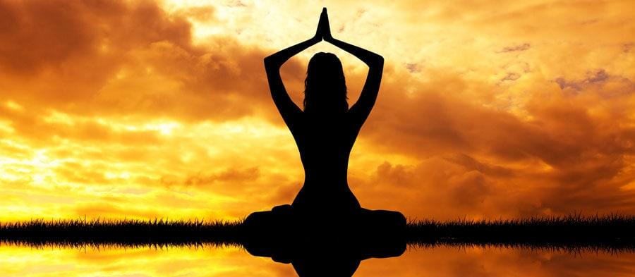 Woman silhouette meditating visudha chakra