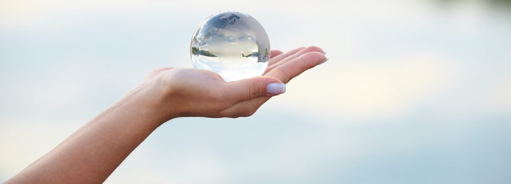 Crystal ball in hand